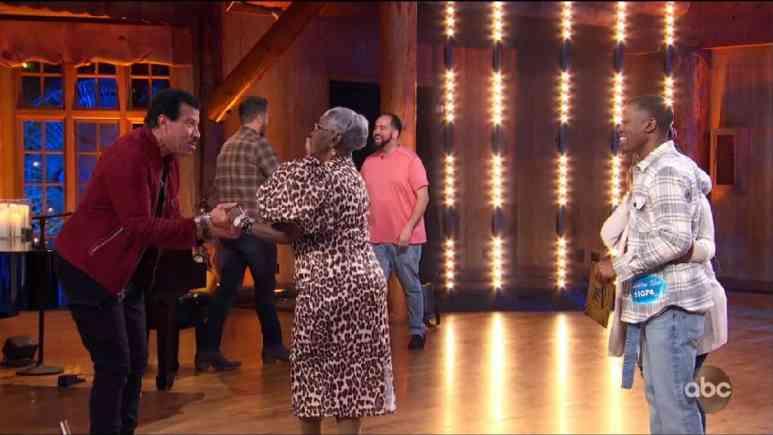 Idol contestant Dwayne Crocker Jr. and his grandma dance with judge Lionel Richie