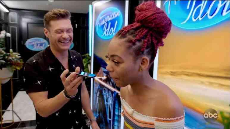 Ryan Seacrest celebrates with Idol hopeful Courtney Timmons