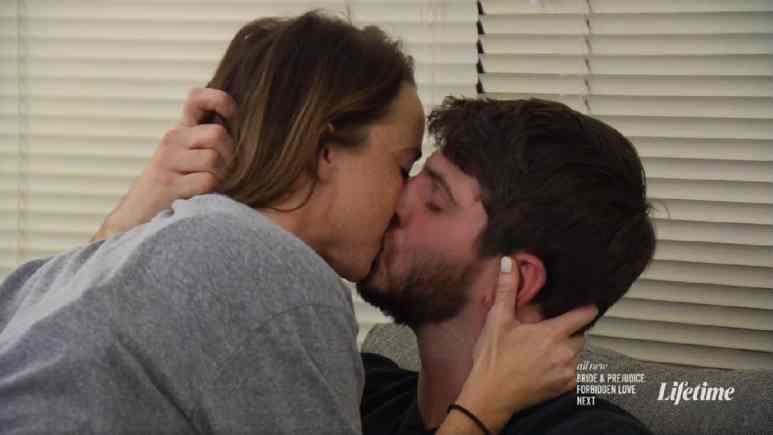 Katie and Derek kiss