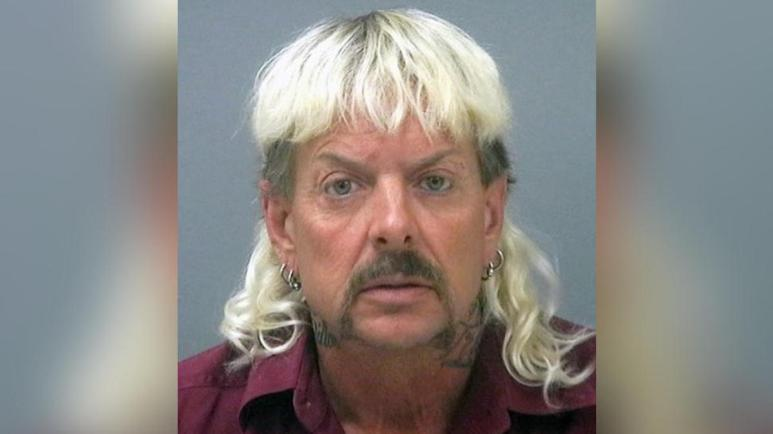 Joe Exotic looks at camera in his mug shot