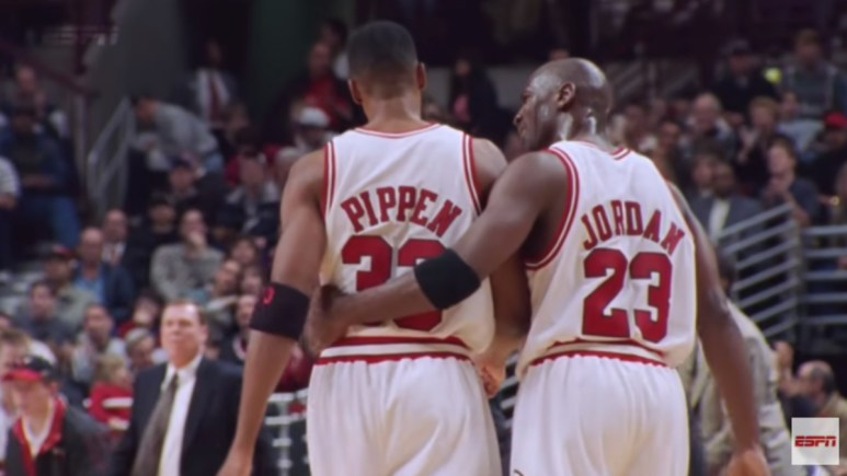 Pippen and Jordan share an embrace on the court
