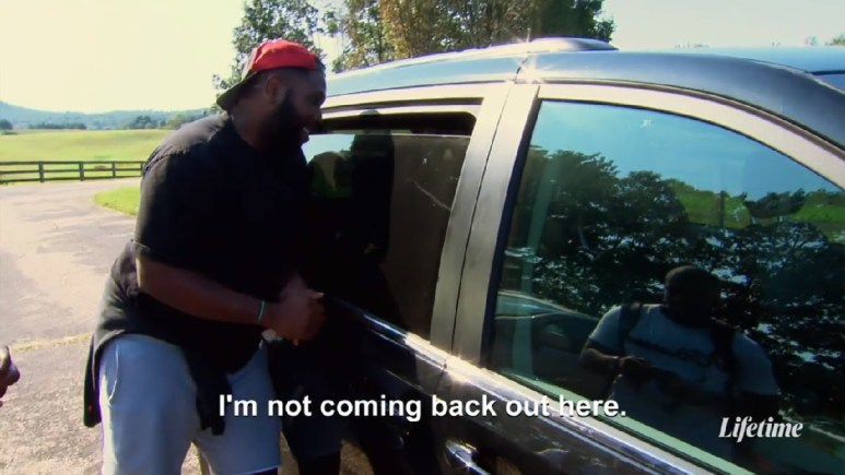 show producer stands outside suv