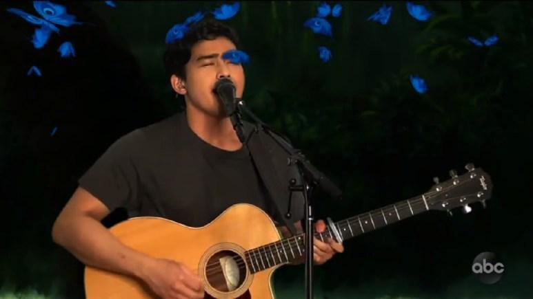 Francisco Martin singing near blue butterflies