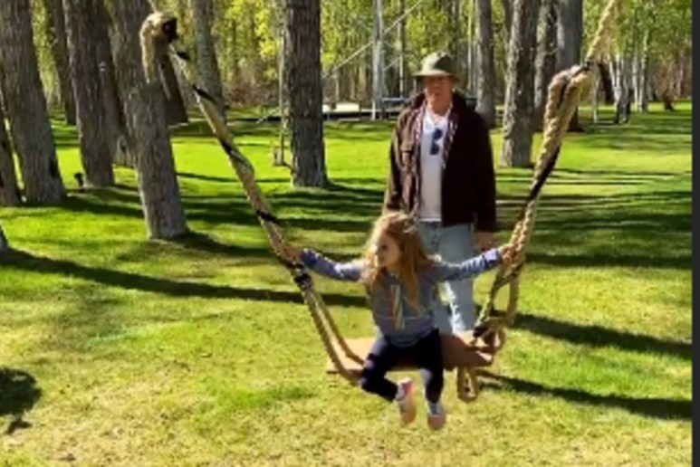 Bruce Willis pushing daughter on swing