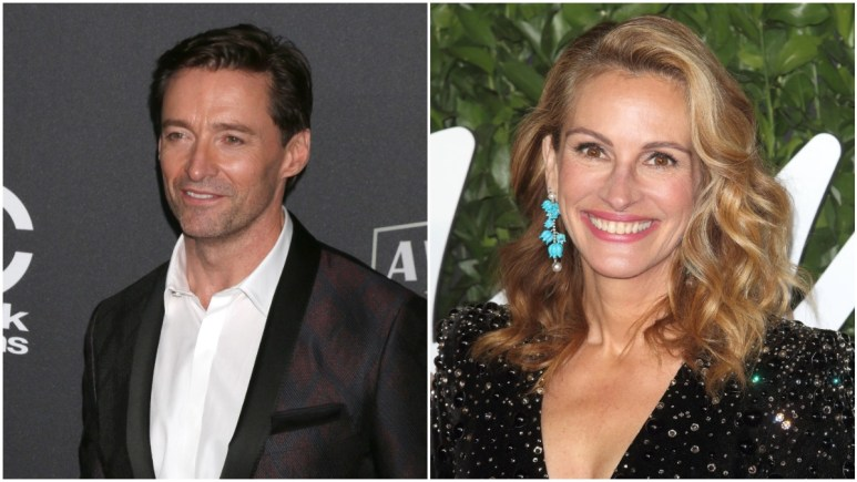 Julia Ronerts and Hugh Jackman posing on the red carpet