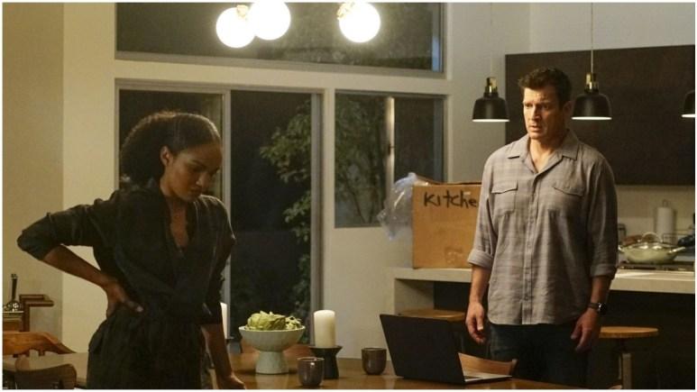 Nolan and Harper talking in the kitchen