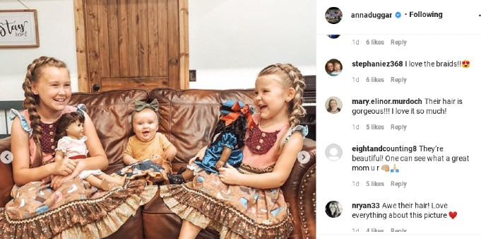 Anna Duggar's daughters with their dolls.