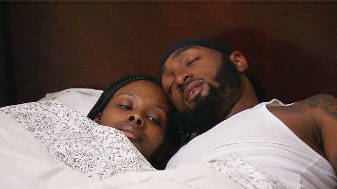 MAFS couple Woody and Amani laying in bed together