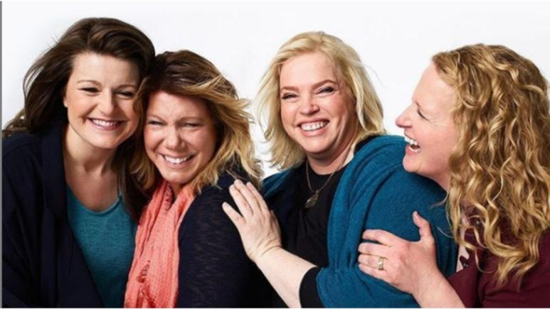 The Sister Wives hugging and smiling together