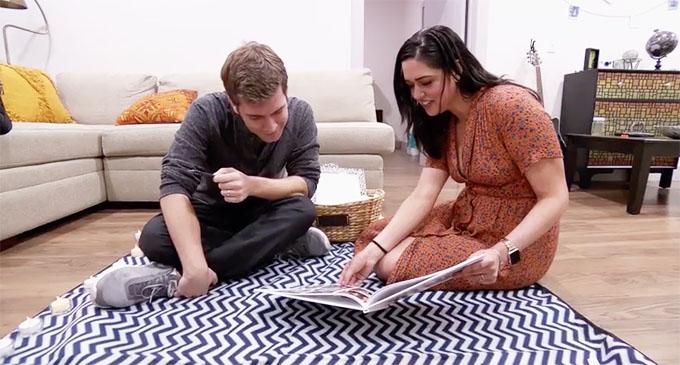 MAFS Season 11 couple Henry and Christina looking at wedding album