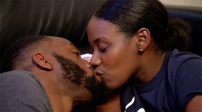 Woody and Amani kissing