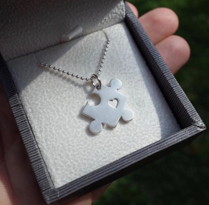 Colt Johnson's puzzle piece necklace