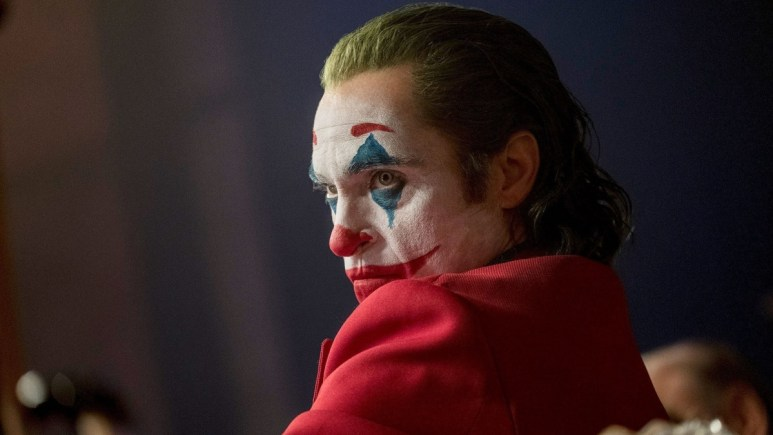 Joaquin Phoenix as Arthur Fleck in Joker makeup.