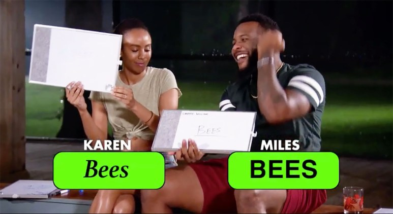 MAFS Season 11 Miles and Karen holding up game cards happy