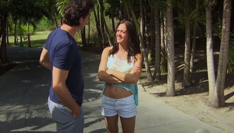 Brooks Forester and Desiree Hartsock talking together in the jungle