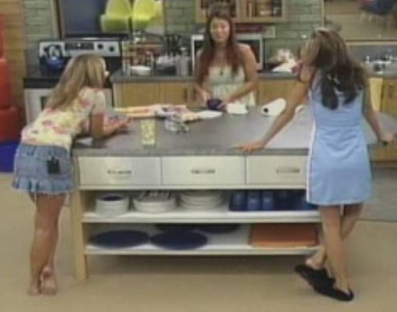 Alison Irwin, Erika Landin and Jun Song stand around the kitchen counter.