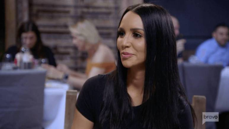 Scheana Shay looks off to the side of the camera while filming Vanderpump Rules.
