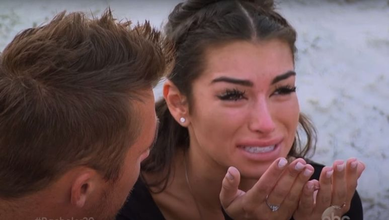Ashley Iaconetti crying next to Chris Soules