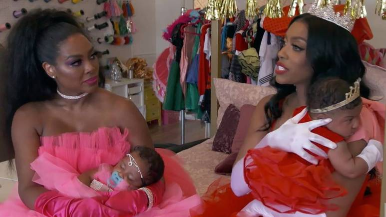 Portia Williams and Kenya Moore have a moment of peace during Kenya's Barbie party.