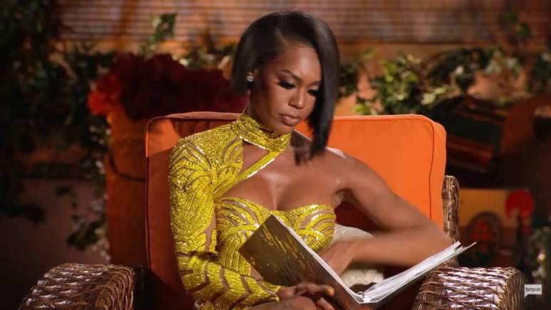 Monique Samuels flips through her binder at the RHOP reunion.