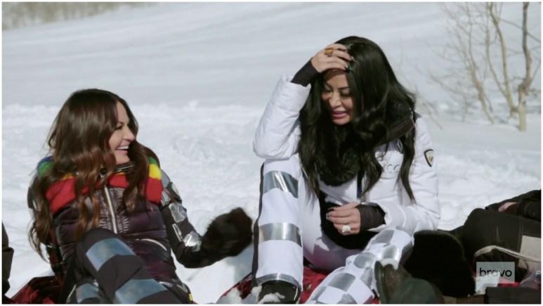 RHOSLC stars Lisa Barlow and Jen Shah taking a break after snowmobiling.