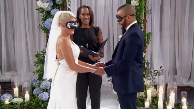 MAFS 12 couple Clara and Ryan blindfolded holding hands at wedding altar