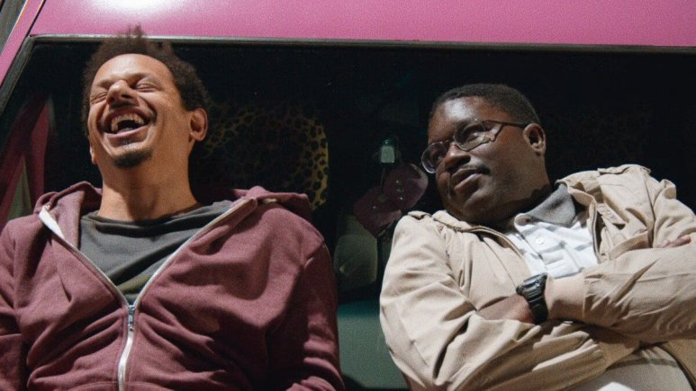 A promotional still of Eric Andre and Lil Rel Howery in Bad Trip.