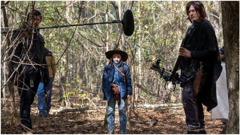 Cailey Fleming as Judith Grimes and Norman Reedus as Daryl Dixon, as seen in Season 10 of AMC's The Walking Dead