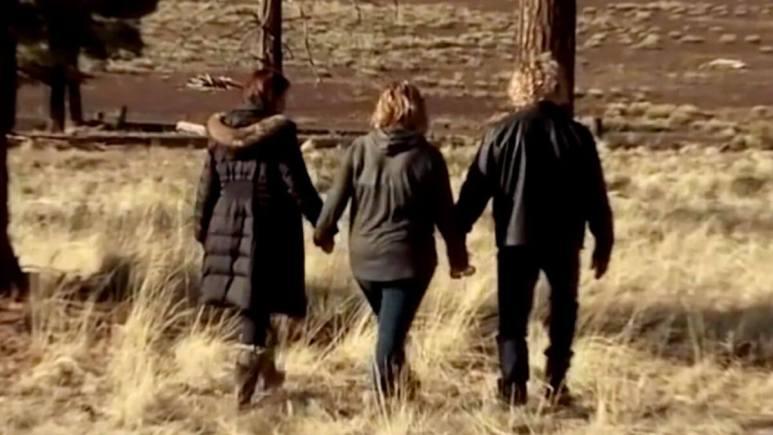 Meri Brown holding hands with daughter Mariah and husband Kody.