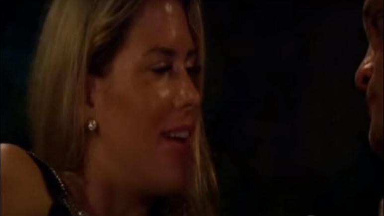 Juelia Kinney looks at Joe Bailey after the two share a kiss