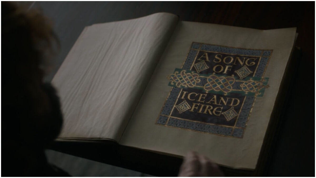 Tyrion Lannister reads A Song of Ice and Fire, as seen in Season 8 of HBO's Game of Thrones