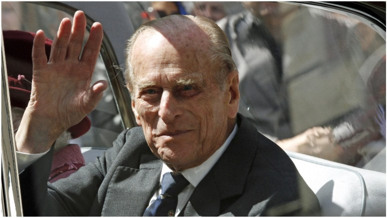 Prince Philip waving from a car