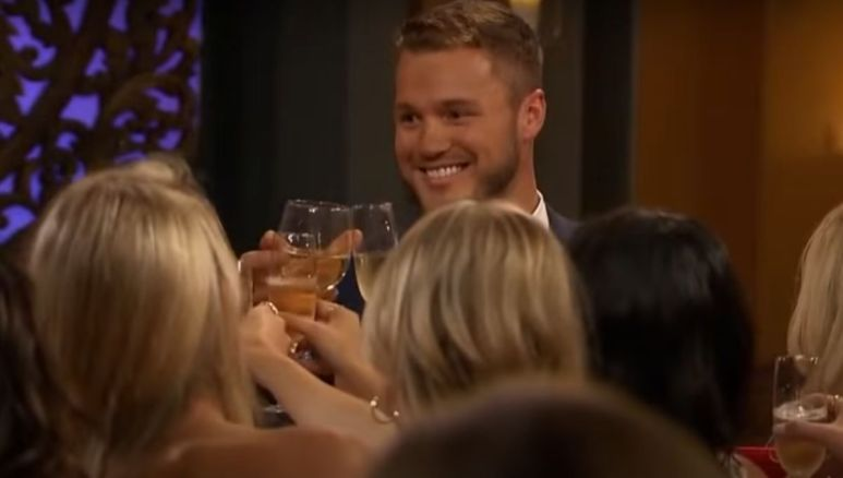 Colton Underwood giving a toast