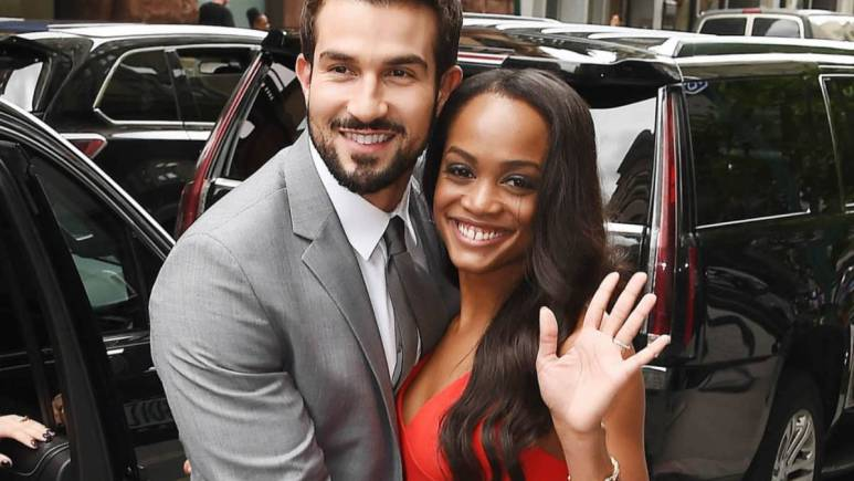 Rachel Lindsay and Brian Abasolo pose on the street for pictures