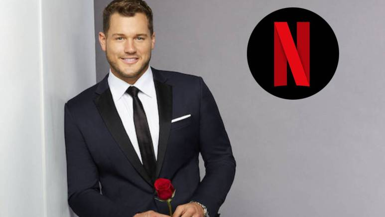 Colton Underwood poses with the Netflix logo