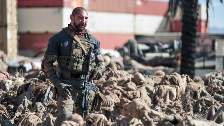 Dave Bautista standing in the bones of bodies in Army of the Dead