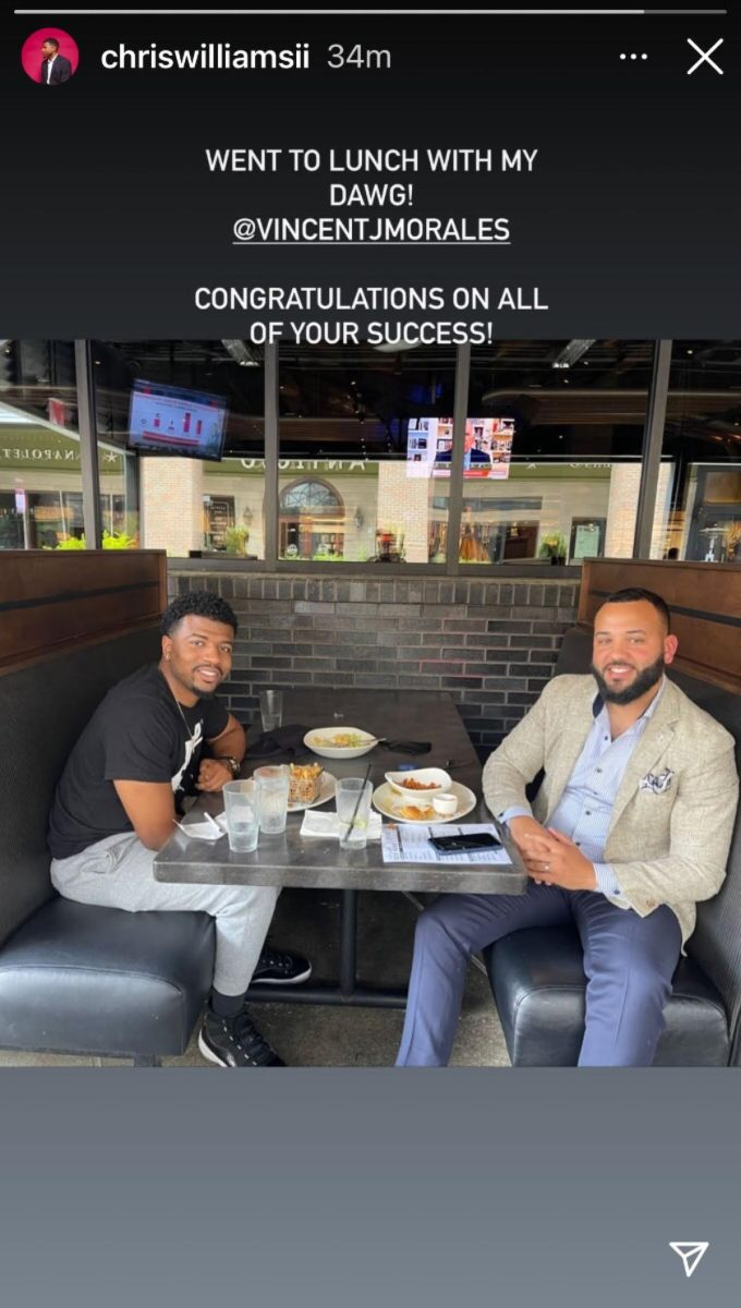 Chris and Vince sit in a booth and have lunch