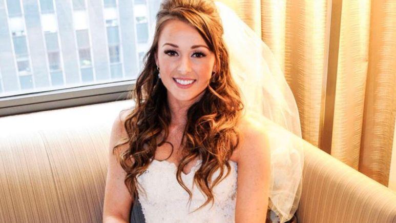 Jamie Otis smiles in a white wedding dress and veil on her wedding day