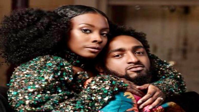 Woody and Amani wrap their arms around each other for a bridal magazine photoshoot