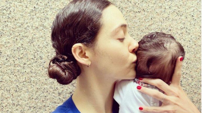 Image of Emmy Rossum and her newborn.