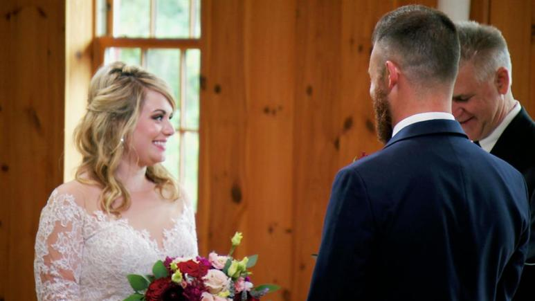 Kate and Luke smile at each other on their wedding day