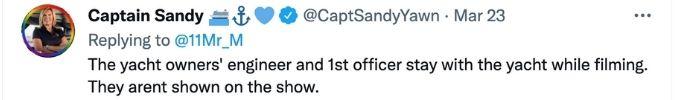 Captain Sandy talks crew members not onscreen.
