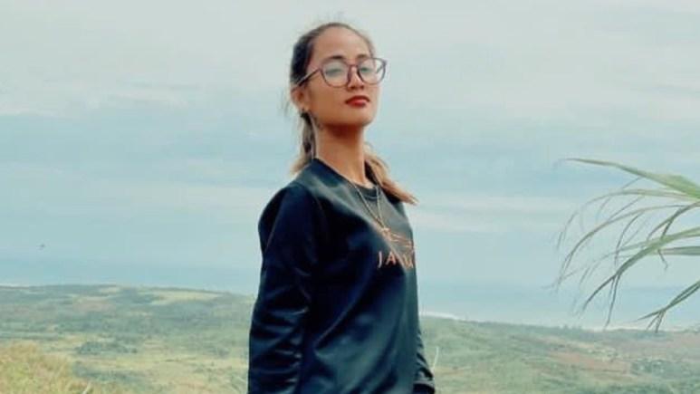 Rose Vega on top of a mountain.
