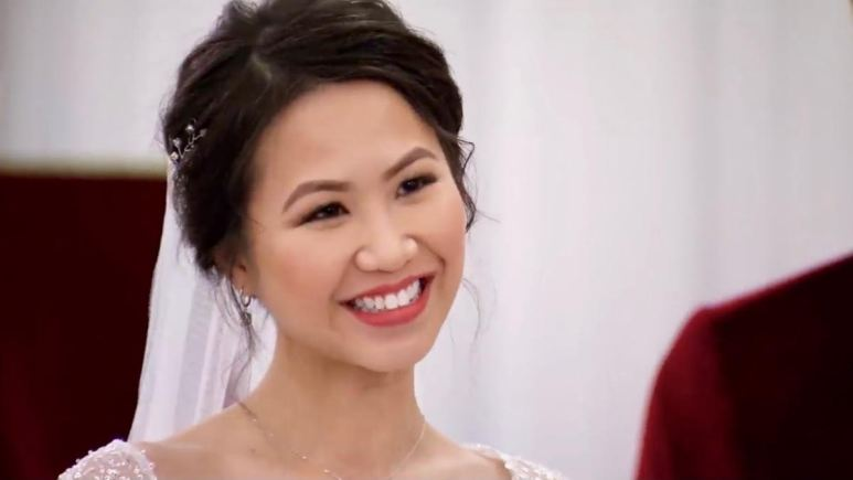 Bao smiles brightly in her wedding dress