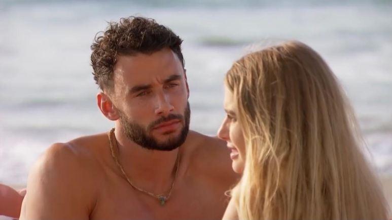 Brendan Morais stares at Demi Burnett on the beach