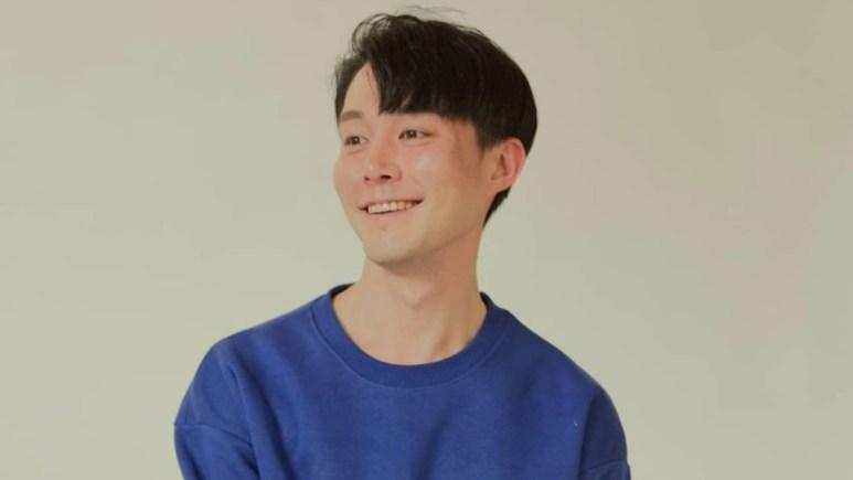 Jihoon Lee in a blue sweatshirt.