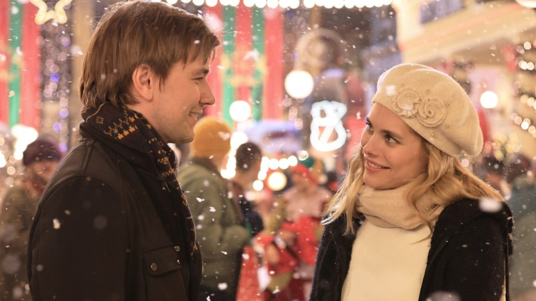 Susie Abromeit and Torrance Coombs in the GAC Family movie Much Ado About Christmas