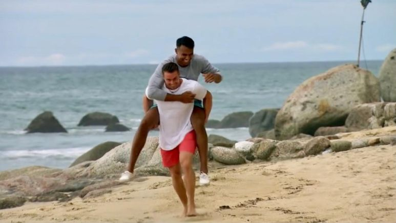 James Bonsall gives Aaron Clancy a piggy back ride on the beach