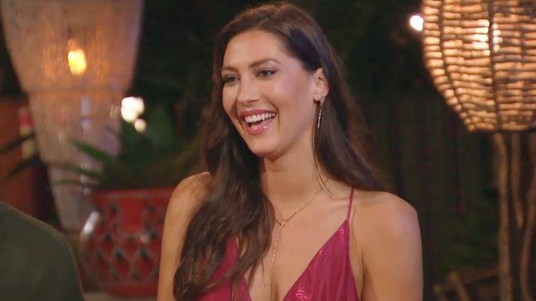 Becca Kufrin smiles