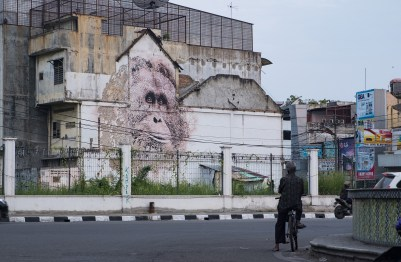 Alexandre Farto aka Vhils Image Credit Ernest Zacharevic man with bike